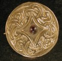 Viking garnet disk brooch