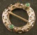 Ring brooch with two stones